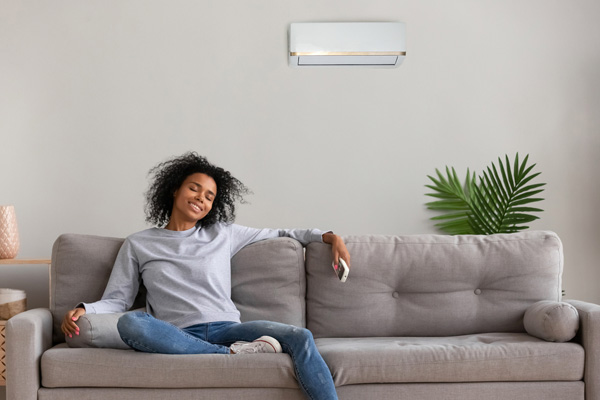 woman enjoying her ductless mini-split system